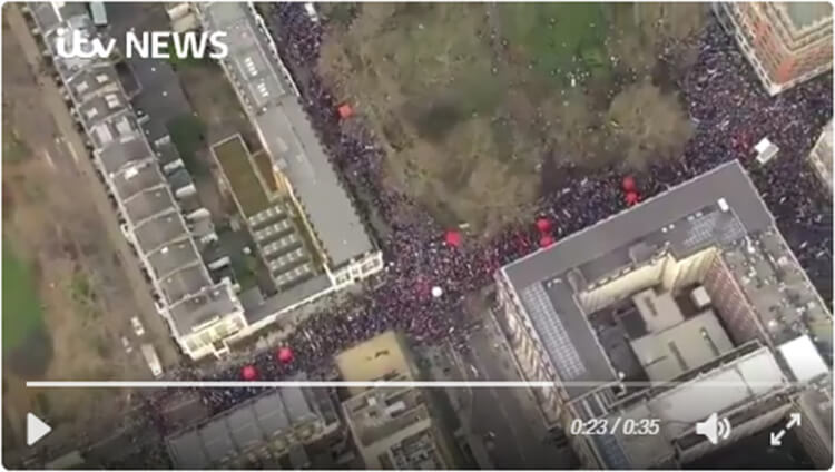 Screenshot of crowds, ITV news